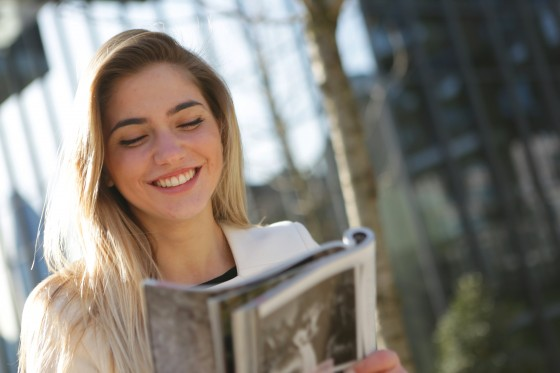 woman-in-white-top-while-holding-book-3781649